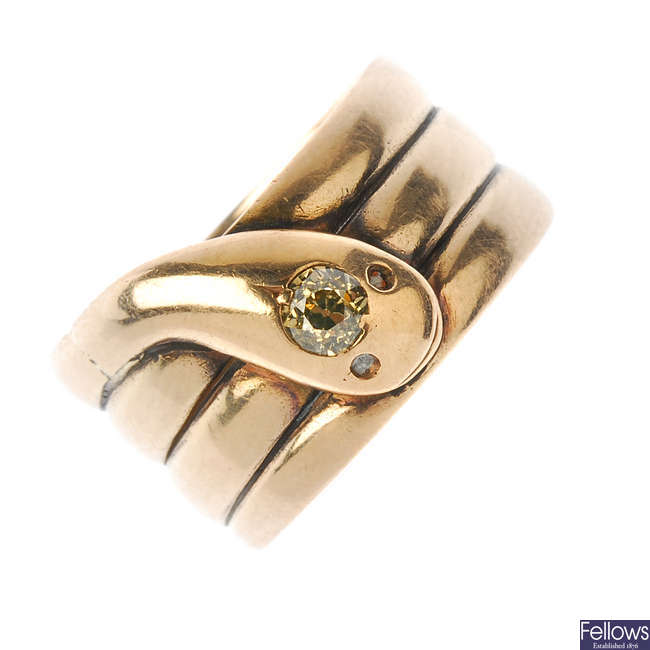 An early 20th century 9ct gold diamond coiled snake ring.