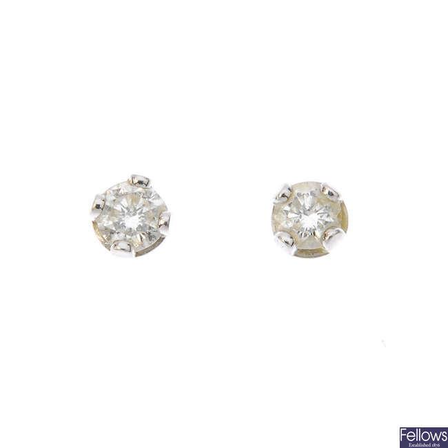 Two pairs of brilliant-cut diamond ear studs.