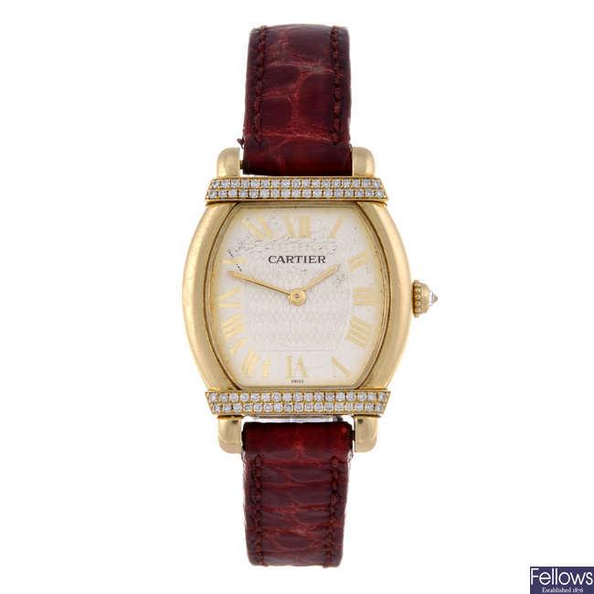 CARTIER - a diamond set 18ct yellow gold Tortue wrist watch.