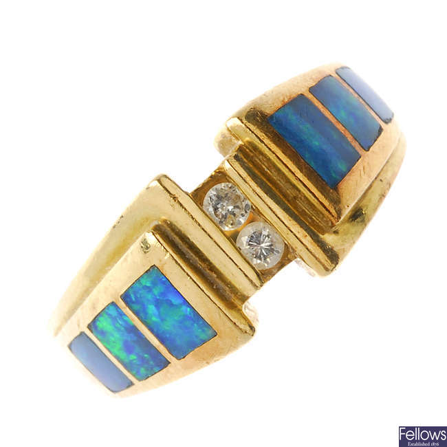 A diamond and opal doublet dress ring.