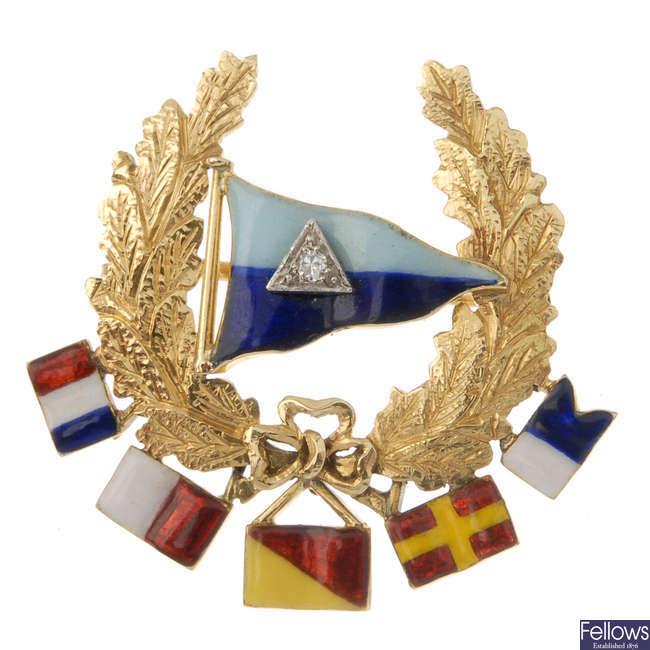A mid 20th century diamond and enamel flag brooch.