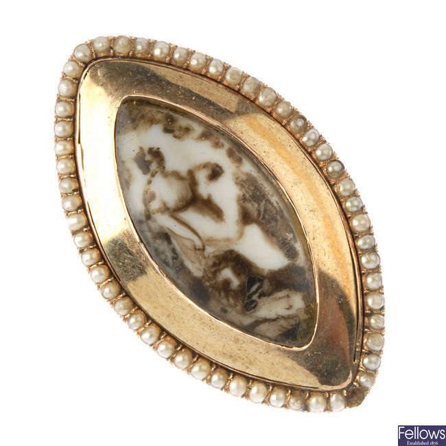 An early 19th century gold ivory and seed pearl mourning ring.