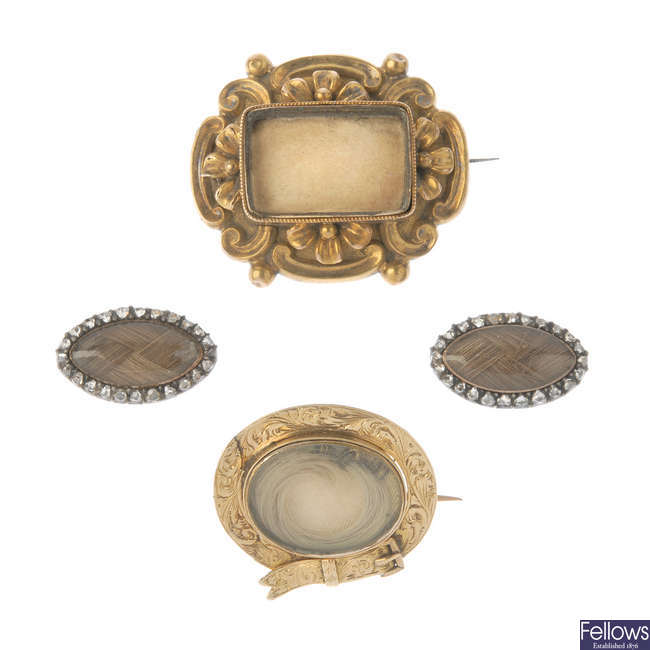 Two mid Victorian mourning brooches and a pair of diamond mourning panels.