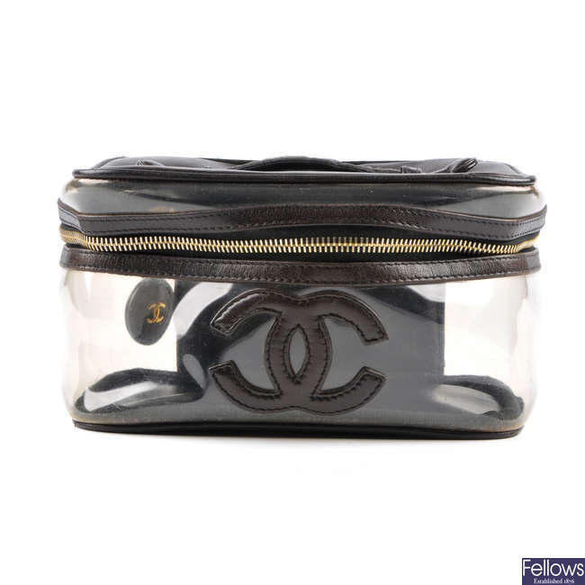 CHANEL - a clear cosmetics bag.