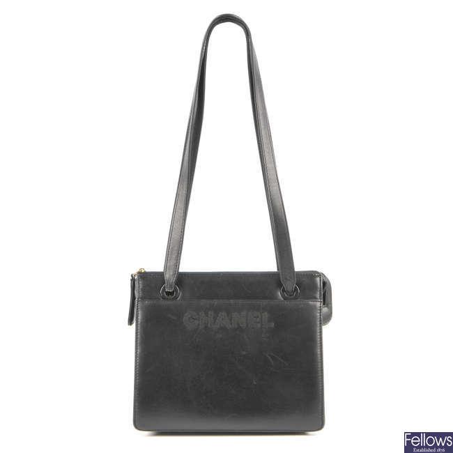 CHANEL - a leather handbag.