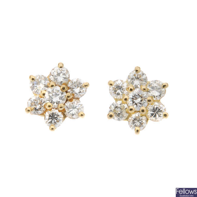 A pair of 18ct gold diamond cluster ear studs.