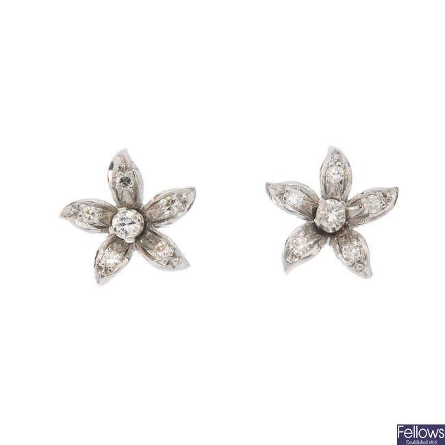 A pair of diamond floral ear studs.