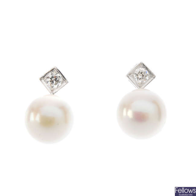 A pair of cultured pearl and diamond ear studs.