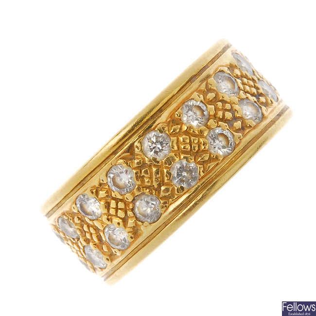 An 18ct gold diamond band ring.