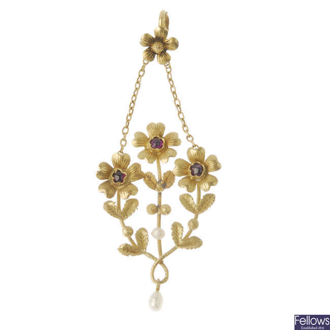 An early 20th century 18ct gold gem-set floral pendant.