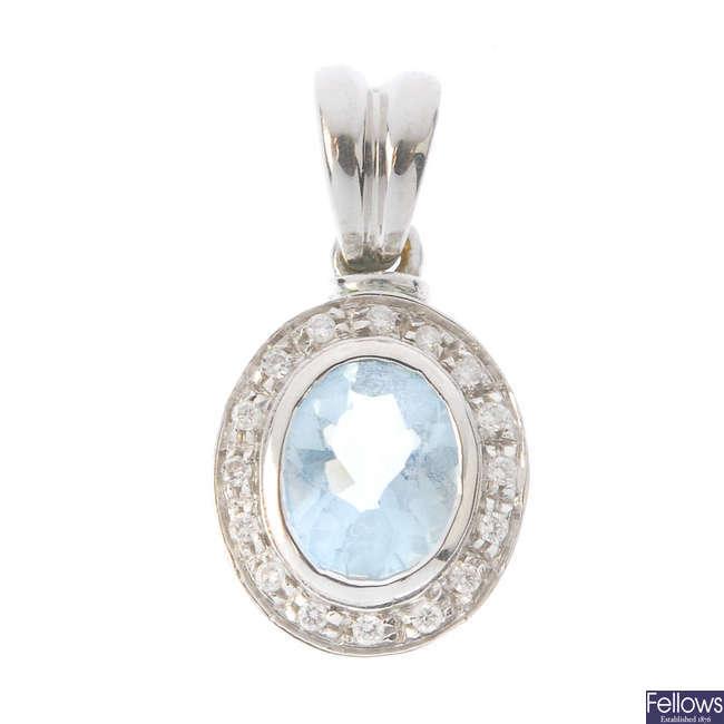 An aquamarine and diamond cluster pendant.