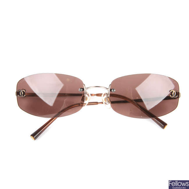 CHANEL - a pair of frameless sunglasses.