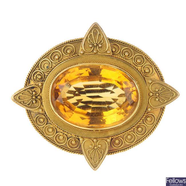 A late Victorian Etruscan gold citrine brooch, circa 1880.