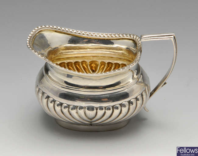 A late Victorian silver cream jug, plus two silver salts, etc.