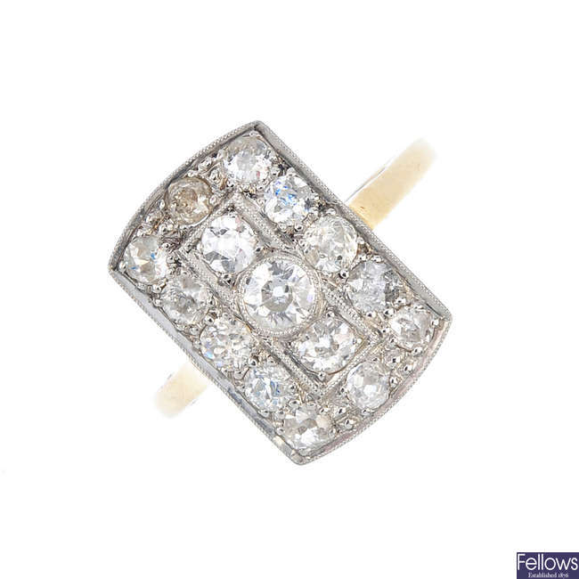 An mid 20th century platinum and 18ct gold diamond dress ring.