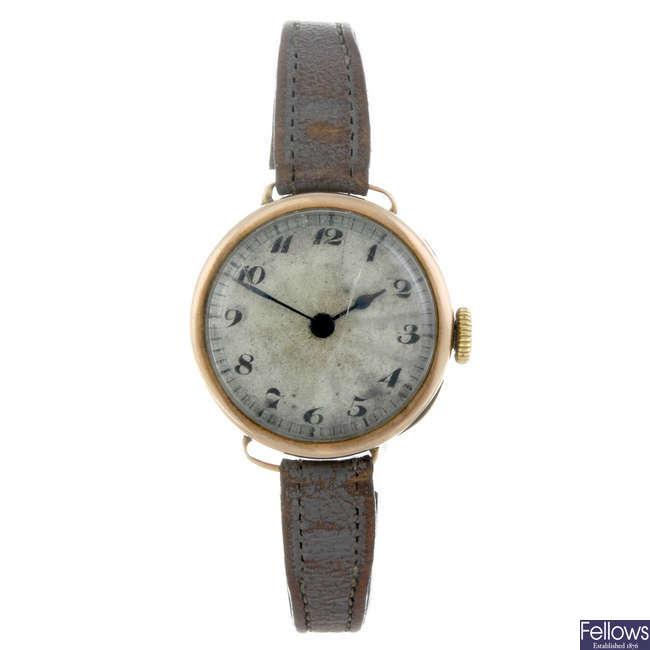 ROLEX - a lady's 9ct gold wrist watch.