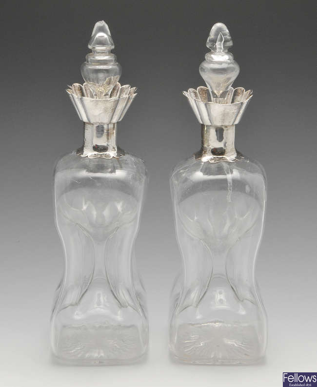 A pair of late Victorian Scottish silver mounted 'glug glug' decanters.
