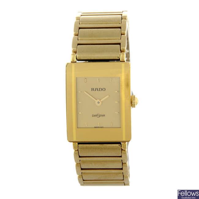 RADO - a lady's gold plated bracelet watch.