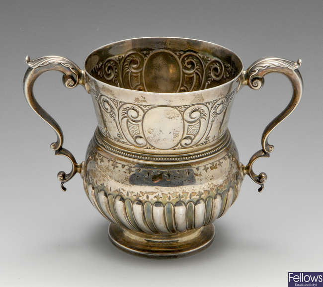 A late Victorian silver twin-handled cup.