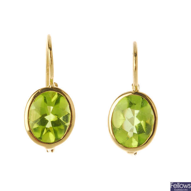 A pair of peridot earrings.