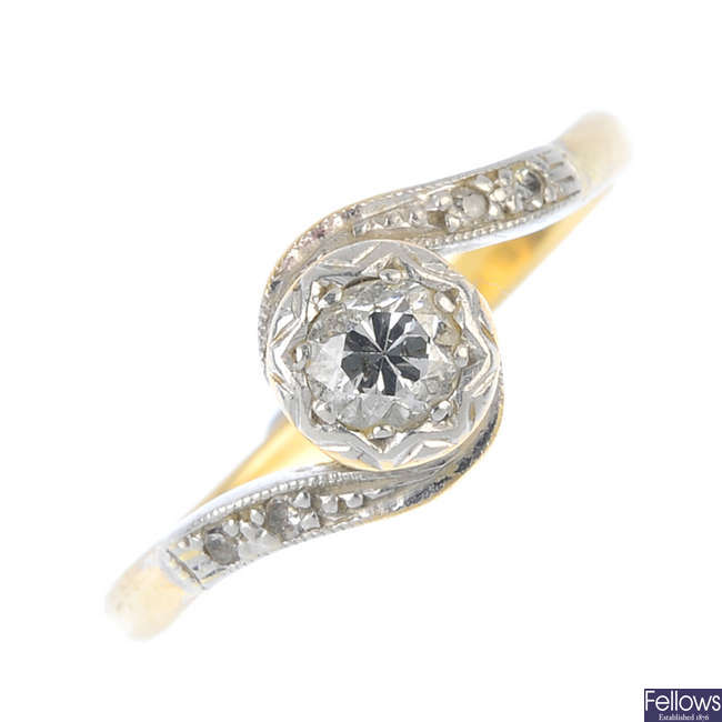A mid 20th century 18ct gold diamond single-stone crossover ring.