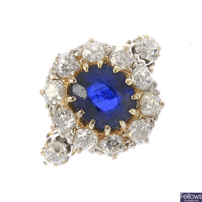 An early 20th century 18ct gold and platinum sapphire and diamond cluster ring.