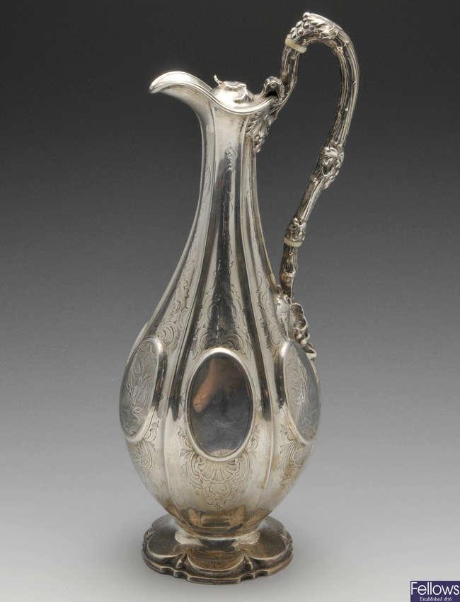 A Victorian silver ewer.