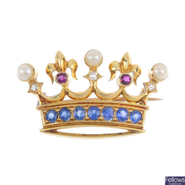 An early 20th century 15ct gold gem-set crown brooch.