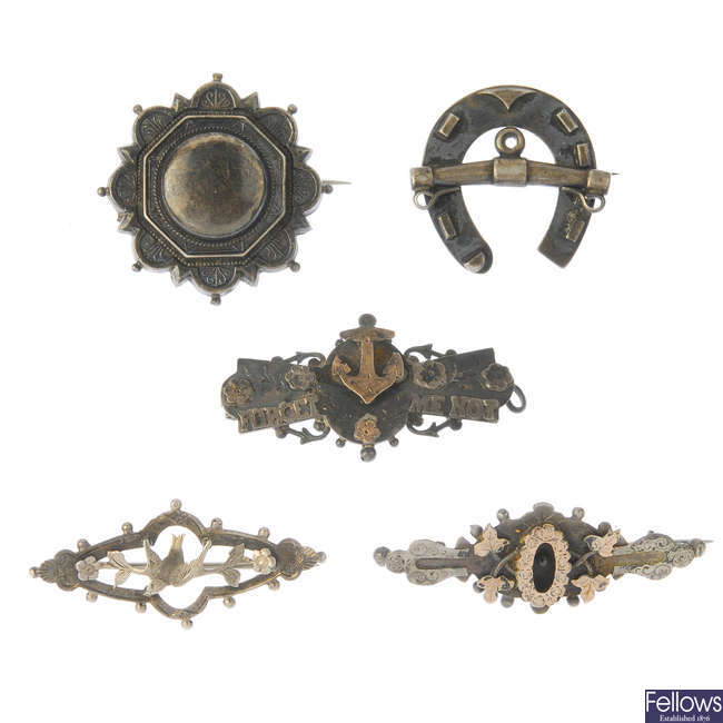 Fourteen late 19th to early 20th century silver brooches.