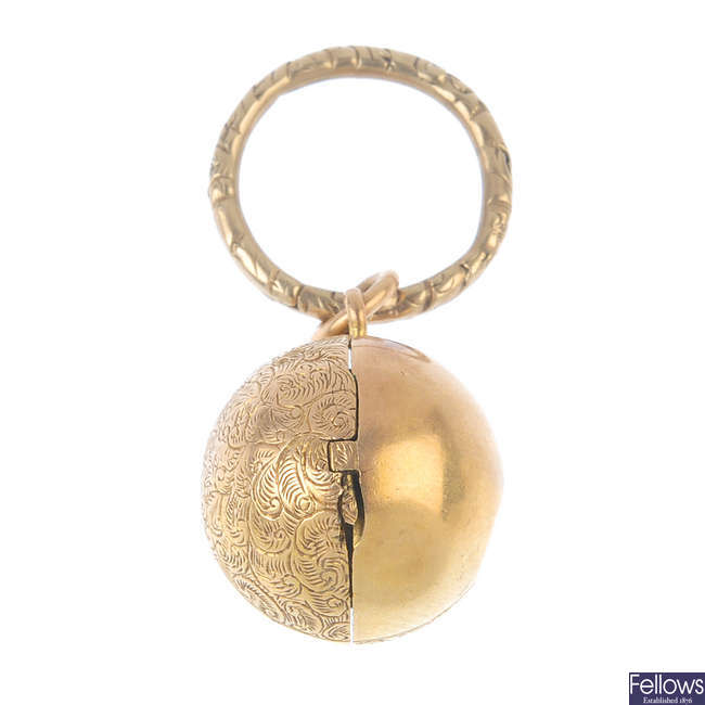 A late Victorian gold locket and late Georgian gold suspension loop.