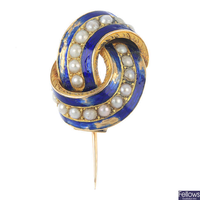 A mid 19th century gold, split pearl and enamel brooch.