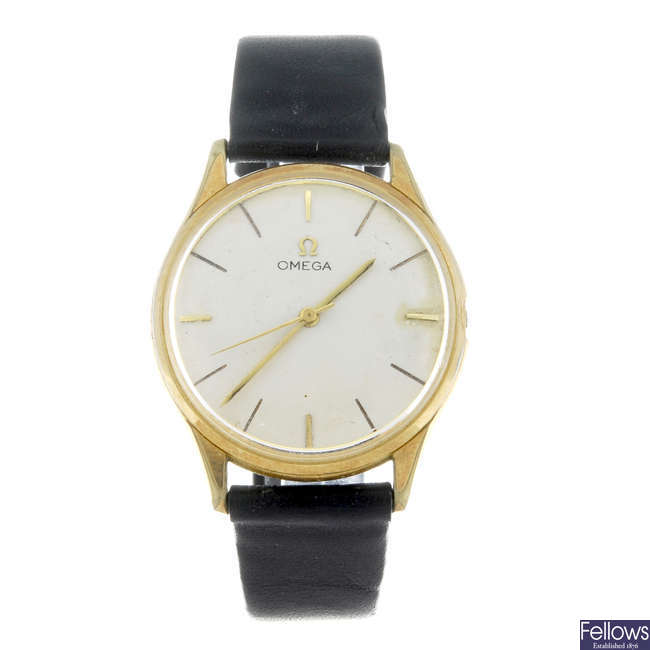 OMEGA - a gentleman's gold plated wrist watch with eight day pocket watch.
