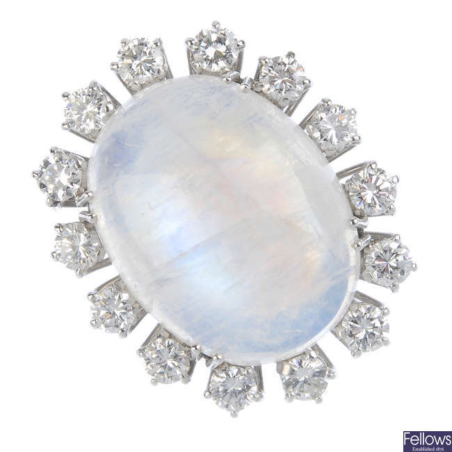 A moonstone and diamond cluster ring.
