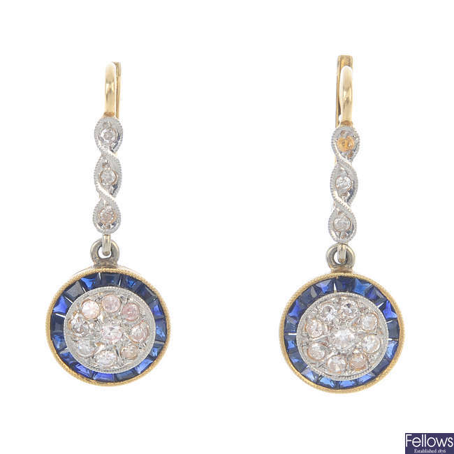 A pair of diamond and sapphire earrings.