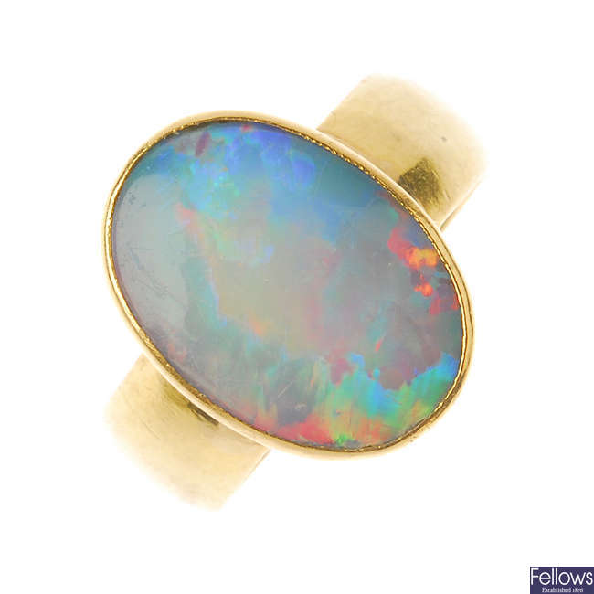 A late Victorian 22ct gold opal doublet ring.