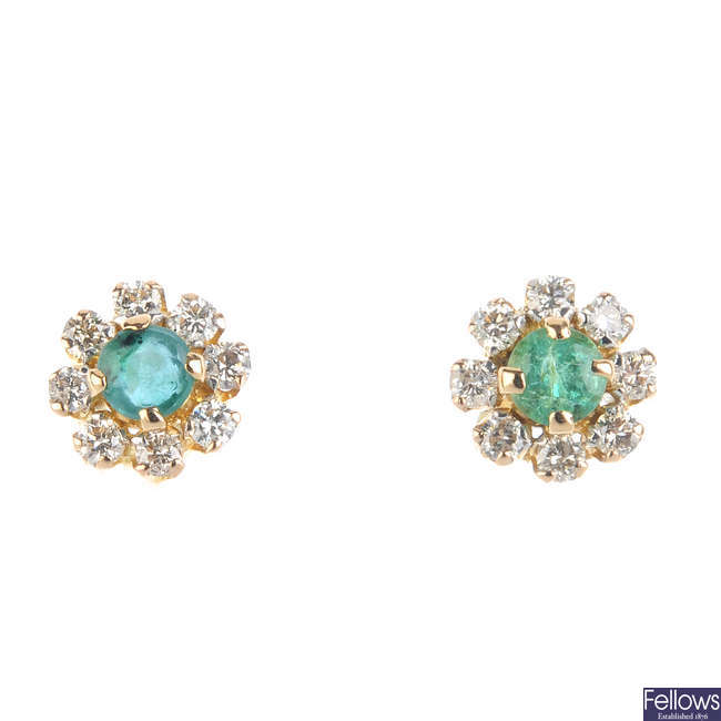A pair of 18ct gold emerald and diamond cluster ear studs.
