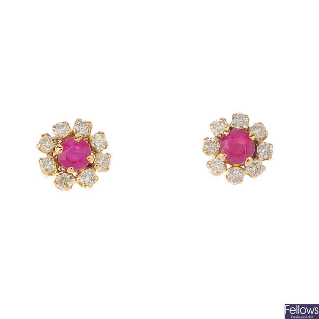 A pair of 18ct gold ruby and diamond floral cluster ear studs.