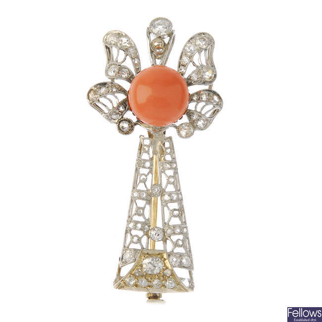 A coral and diamond brooch.