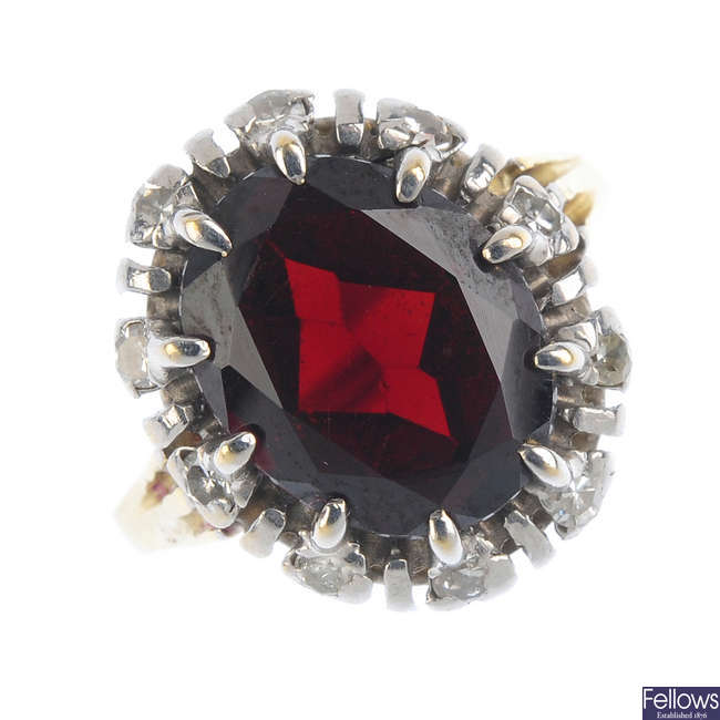A garnet and diamond cluster ring.