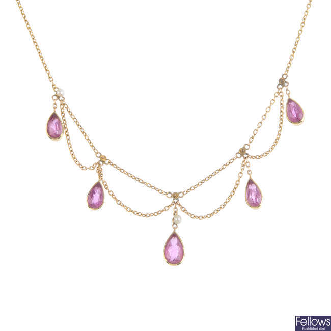 An Edwardian 9ct gold tourmaline and seed pearl necklace.