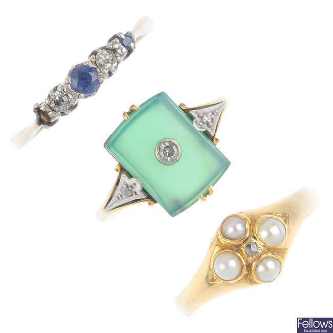 Three gem-set dress rings and a brooch.