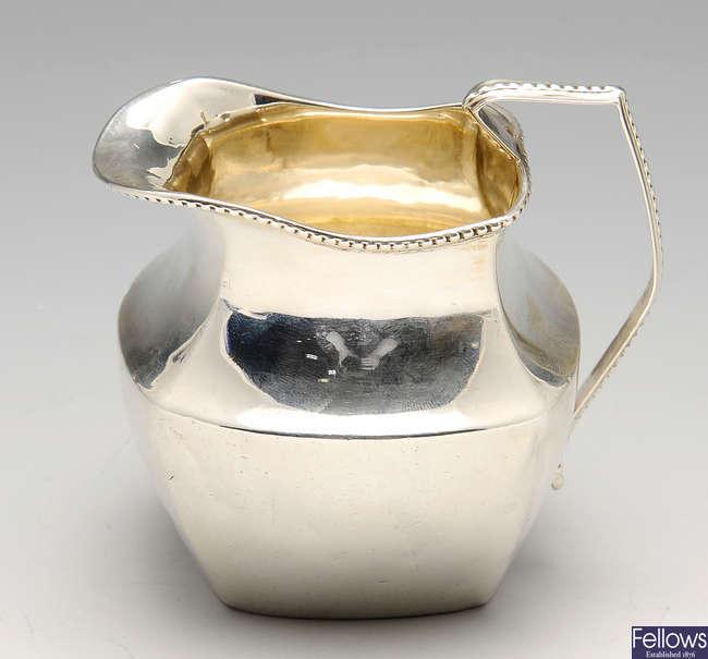 An Edwardian silver cream jug, etc.