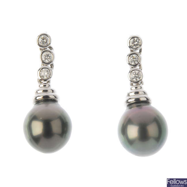 A pair of 18ct gold cultured pearl and diamond earrings.