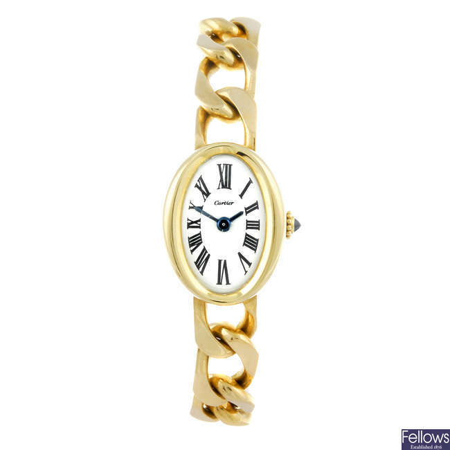 CARTIER - an 18ct yellow gold Baignoire bracelet watch.