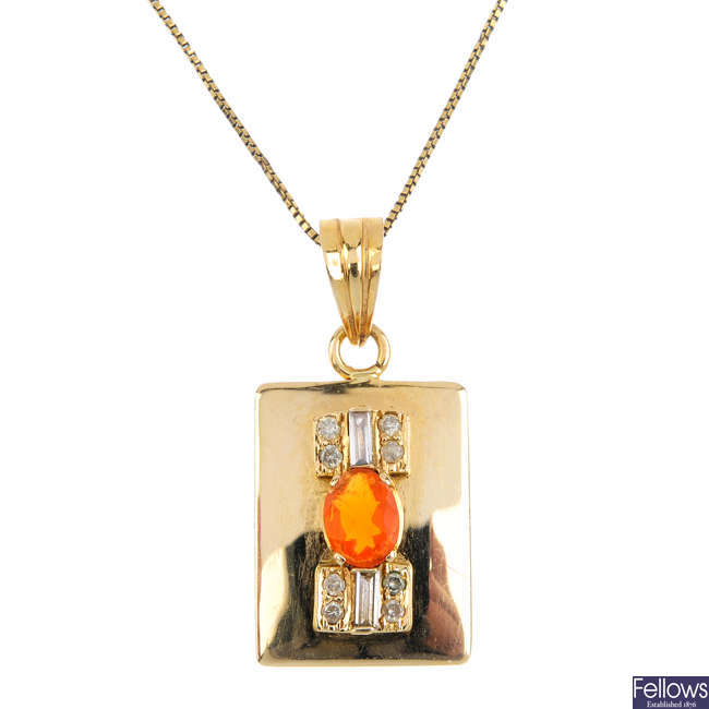 A fire opal and diamond pendant, with chain.
