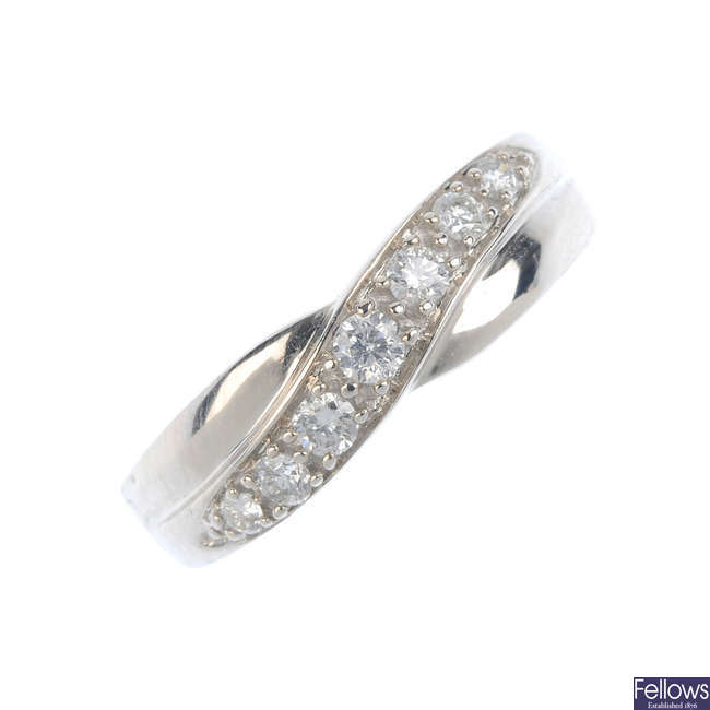 A 9ct gold diamond crossover band ring.