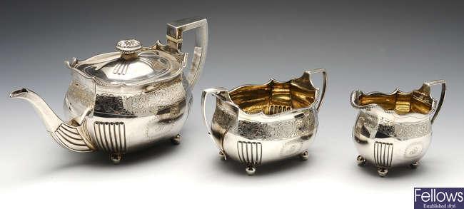 A George III silver three piece tea service.