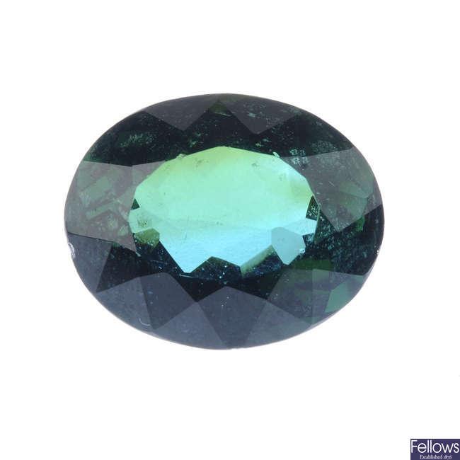 An oval-shape tourmaline, weighing 12.82cts.