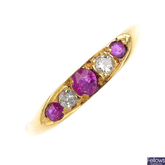 A ruby and diamond five-stone ring.
