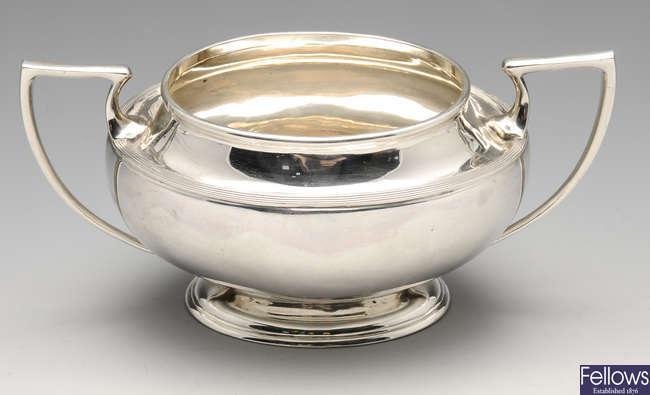 A George V silver twin-handled sugar bowl.
